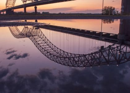 gray steel bridge over body of water during night time